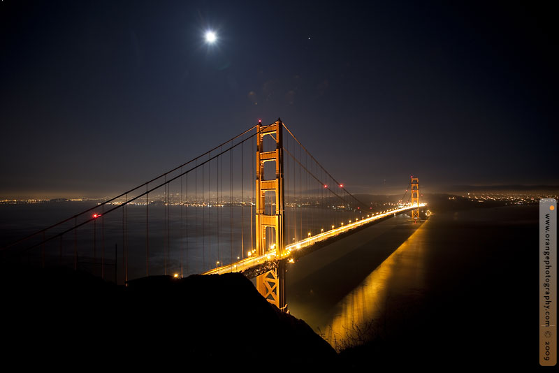 golden gate bridge moon night jupiter stock photo
